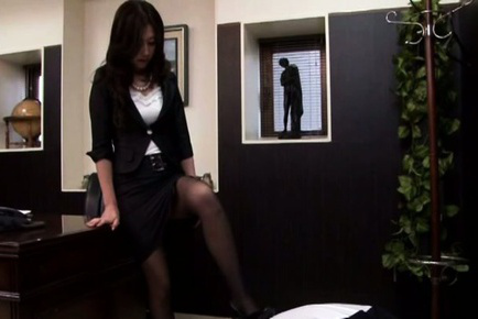 Japanese av model. Japanese AV Model shows hot booty in stockings on boss chair