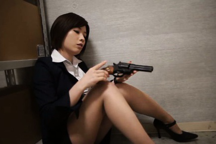 Saki okuda. Saki Okuda Asian in office suit puts gun in her