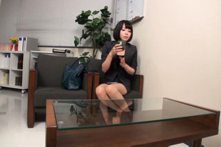 Japanese av model. Japanese AV Model in office outfit touches cock with gloves