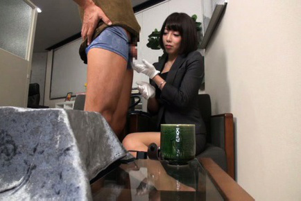 Japanese av model. Japanese AV Model in office outfit touches penish with gloves
